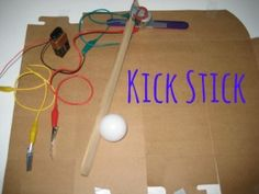 Kick Stick: Ping Pong ball, 3 volt motor, wires, battery and paint stirrers create a motorized arm--kicking stick--to hit the Ping Pong ball across the floor