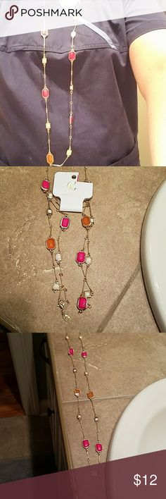 Long gold layering fashion necklace Long gold layering neck lace with pink, orange and white stones. New with tags. unknown Jewelry Necklaces