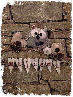 Felt Owl and hearts on a twig, welcome sign. Pinecones