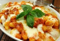 Baked gnocchi with mozzarella, basil and fresh tomato sauce. I would give anything for authentic Italian gnocchi Baked Gnocchi, Gnocchi Recipes, Italian Pasta Recipes Authentic, Italian Recipes, Mozzarella, Vegetarian Recipes, Cooking Recipes, Food Names, Italian Dishes