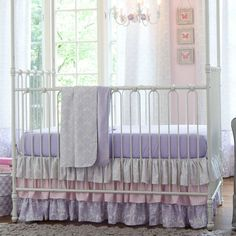 Lilac and silver gray damask crib bedding from Carousel Designs—perfect for your purple nursery