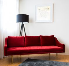 A velvet couch in scarlet red is reminiscent of the seats inside the opera hall.