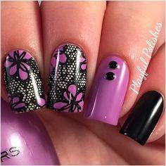 Black and purple lace nail art design.