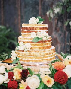 A lemon cake—the bride's favorite flavor—with buttercream was decorated with spray roses.