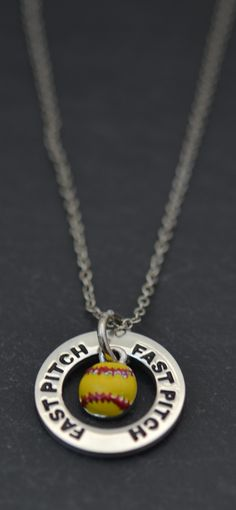 For the softball pitcher, this Fast Pitch nacklace will make the ultimate softball gift! It comes complete with our 'fast pitch' message ring and enamel softball charm! Featured here on a silver link chain. Makes a cool softball birthday gift too!