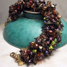 Beadwork Bracelet in Browns, Rust, Earthtones, Beadweaving Bead Embroidery ' Ice Tea'. $85.00, via Etsy.
