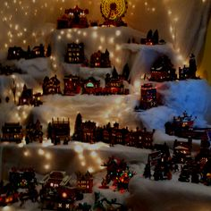 This year's christmas village ...  Stack boxes  in shelf then cover with snow for height And depth,