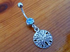 Sand dollar and Light Blue gem Belly Button Ring
