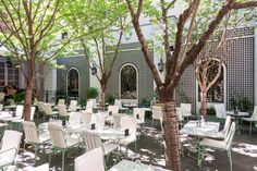 Furnished with an urban #orchard of #cherrytrees, formal #French #trellising, and an #antique #fountain, the outdoor space of #Ladurée provides visitors with the illusion that they are dining on the romantic streets of #Paris.