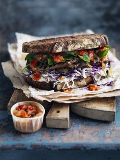 Steak sandwich with coleslaw and tomato chilli relish