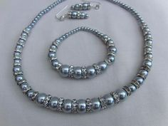 Silver Grey Pearl Bridal Jewellery Set, Necklace, Bracelet, Earrings, Wedding, Silver Grey Pearl, Bride, Bridesmaid, Wedding, Accessories  This beautiful Grace jewellery set comprises a necklace, bracelet and pair of earrings and it would perfectly complement any dress or outfit that you choose for your special day. It would also make an ideal gift for your bridesmaids or flower girl.  The necklace is made using graduated silver grey glass pearls and clear crystal rondelle spacer beads.