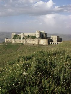 """EARLY MEDIEVAL:  Crac de Chevaliers or known as """"Castle of the Knights."""" Built in Syria 1086 until about the 14th century CE."""