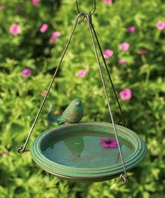 Enhance your bird garden with exciting color using this Teal Ceramic Hanging Bird Bath. This teal colored, round, hanging ceramic birdbath is decorated with matching metal-tailed bird. It comes with a sturdy metal hanger that can be hung from a tree or shepherd's hook ~ Happy Birding from friends at JacobsOutdoor!