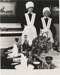 """Bill Brandt (British) Parlourmaid and Under-Parlourmaid Waiting to Serve Dinner, London, 1939. """"The extreme social contrast during those years before the war was, visually, very inspiring for me. I started by photographing in London, the West End, the suburbs, the slums. I photographed everything that went on inside the large houses of wealthy families."""""""