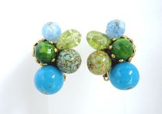 Something Special for Her! Stunning Hattie Carnegie 1960s Glass and Lucite Gold Tone Metal Clip on Earrings.  Shades of Green and Blue Glass and Lucite Beads on a gold tone metal clip.  The earrings ...