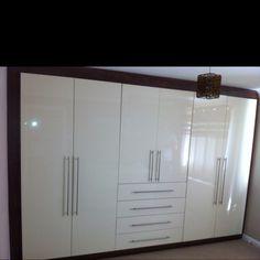 A gloss cream and walnut wardrobe