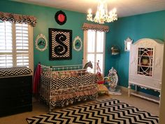 This nursery has so many great chevron accents!  #chevron #black #nursery #turquoise