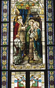 Stained glass portrait of religious scene
