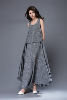 Youll create an entrance wherever you go with this beautifully flowing gray linen dress. Flaunting gorgeous layers, the dress is perfect for cool summer days and has a romantic feel. The dress no sleeve, a fit and flare style and a round scoop neck.  Super feminine and sophisticated, this soft gray linen dress is a must-have for any summer wardrobe. Youll be able to wear it to garden parties or BBQs or for a romantic lunch date. Dress it up with some heels or you can also make it look more…