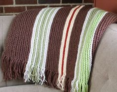 A simple and classic design this vertical striped crochet afghan pattern is a great opportunity to play with those different colors in your stash or perhaps just a good excuse to buy some new yarn! #crochet #fiber