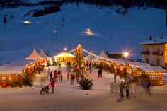 Livigno Christmas Market, Italy - This is one of the most famous Christmas markets in the Lombardia area, in the very northern part of Italy (Italian Alps) next to Switzerland. Between browsing the wooden houses of the Christmas Market, you can sample   the alpine pastries with a vin brulé, a spiced warm red wine.