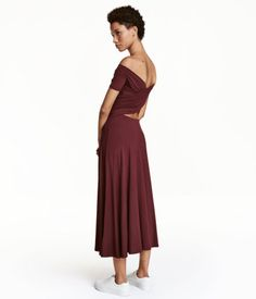 Burgundy. Calf-length, off-the-shoulder dress in soft jersey. Elastication at top, wrap section at top back, and a seam at waist with cut-out section at