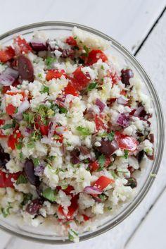 Cauliflower Rice Tabouleh - cauliflower, olive oil, chicken/veggie stock, salt, red onion, red pepper, pitted kalamata olives, fresh parsley, fresh mint, lemon, salt & pepper