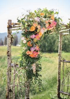 Arch perfection. Photography: Blue Rose Photography - www.bluerosepictures.com, Floral Design: Patti Bosket Au Naturel - http://www.pattibosket.com Read More: http://www.stylemepretty.com/2014/07/14/rustic-mountain-wedding/