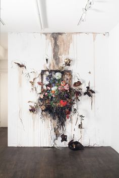 VALERIE HEGARTY Get a frame and glue flowers and leaves and branches to it like is growing out of it. Love this idea.
