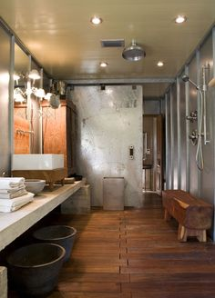 Don't know about the open shower, but the bench is really cool.  Awesome Manly Reclaimed Bathroom...Open Shower