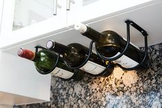 An under-cabinet wine rack because having vino in an easy-to-reach place is adult rule number one. 33 Kitchen Products For Anyone Who Basically Has No Cabinet Space Small Kitchen Organization, Organization Hacks, Kitchen Storage, Organizing Tips, Kitchen Hacks, Kitchen Decor, Organized Kitchen, Kitchen Drawers, Kitchen Ideas