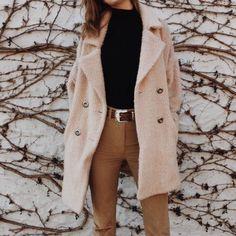 Black high neck black turtleneck tan high waisted pants beige coat pastel pink coat