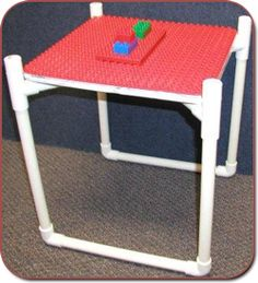 lego table stand from pvc..use plywood for a great looking outside table by lawn chairs!