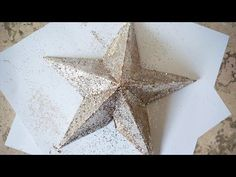 A beautiful and sturdy Christmas star made with cardstock, paste, newspaper strips, paint and glitter!