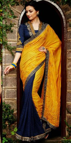 Yellow and Royal Blue Kimora Lehenga Saree with Silk, Jacquard Banarasi Fabric and Dhupion Blouse, The silhouette of blouse portray indian modern aesthetics, having texured saree in blue team with yellow 'pallu' featured tonal stone embellished aari work.