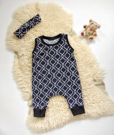 Baby Romper for Girls  This romper is made of a very light and stretchable cotton spandex fabric and perfect for play or just sitting arround. There are no snaps, it goes on through the neck hole. As a Mom of two little kids that has dealt with countless buttons, I think these are way easier!  All seams are professionally serged for durability. Please note that pattern placement will vary, as this product is handmade.  ►TO ORDER  1. Please choose the size and head band option from the drop…