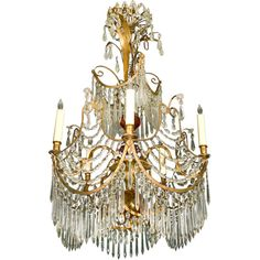 """Baltic six light ormolu and crystal chandelier in the neoclassical taste. CIRCA: 19th Century DIMENSIONS:41"""" h x 23"""" w"""