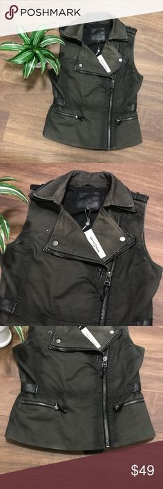 Max Jeans fatigue green and black vest XS NWT, I'm reposhing, after getting this in the mail it's just not really my style. It was a little different than I was expecting. Anyway, I hope this will find a good home and finally get worn!! The material is that of a utility vest, kind of thick denim (fatigue green part) with details of faux black leather. Cute buttons and the zipper is slightly offset. It's really cute on but the only leather I wear is on my feet! When I bought it I thought it…
