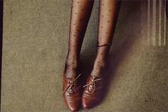 Brown Oxfords and black tights = staple