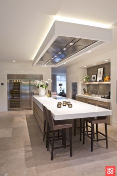 like the sink area with the shelves and the island with the seating - and the white counter is cool