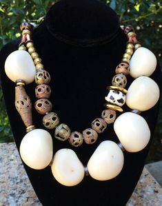 White Tagua: Bold and Organic White Tagua Nut and African Brass Statement Necklace $225