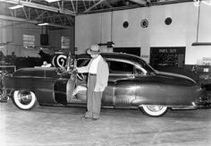 Mobster Mickey Cohen with his bulletproof Cadillac,1950. Oddly enough, he didn't need the bulletproofing.  Mickey did not die in the usual Italian restaurant, barber chair, at the steering wheel of the Caddie or up the river.  Died in 1976 at 63 of natural causes.