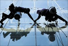 RISING FORTUNES: Two high-rise window cleaners get to work at a   department store in the Siam Square area. They are among the millions of   workers nationwide who are benefiting from the 300-baht daily minimum   wage, which the government has defended by pointing out how no   businesses have closed as a result of its introduction.