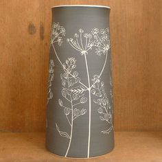 Vase with Cow Parsley and Field Pennycress. I plan to spend much more time this year drawing from nature. I feel like I really need to know a plant well before I can use it on a pot.....with sgraffito you only get one chance once you put tool to pot.  If I'm familiar with the way a plant grows or how the leaves are attached to a stem it's so much easier to depict that in the simple way that sgraffito allows. . . . . #stoneware #sgraffito #ceramics #vase #wildflowers #weeds #seedheads…