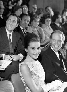Audrey Hepburn photographed with her husband Mel Ferrer at the Cinema Fiammetta during the premiere of The Nun's Story in Rome, Italy, October 08, 1959.