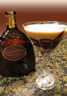 *Godiva Chocolate Martini - 11/2oz. Godiva chocolate liqueur 11/2oz. Creme de Cacao 1/2oz. Vanilla vodka 21/2oz half and half Chocolate syrup for rim