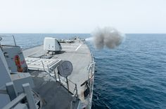 The guided missile destroyer USS Stockdale (DDG 106) fires the MK-45 5-inch/54. lightweight gun during a live fire exercise.