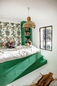 Chez Stéphanie Ferret | MilK decoration // green bed in kids room, wicker light fixture, green wallpaper