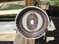Beautiful pine needle basket coiled with long leaf pine needles, sewn with white artificial sinew .center is cameo .embellished with purple glass beads . Measures 8 across and high. Pine Needle Baskets, Buddhist Meditation, Pine Needles, Purple Glass, Basket Weaving, Craft Supplies, Glass Beads, Handmade Items, Ropes