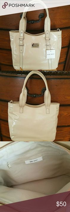 """Nine West Leather Tote Brand new Nine West tote. Oatmeal color. Zipper closure. One zipper pocket inside. Never used. No damages. Needs a little wiping outside. Large enough to carry a tablet. 12"""" x 11"""" x 4.5"""". Nine West Bags"""
